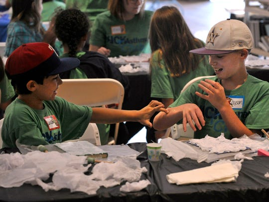 Landon Vaughn, 9, (left) tags Cayson Gossett, also