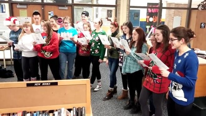 One of four visits the Webster Thomas HS Library was treated to by the Chemistry Carolers on Tuesday. (M. Rosenberry)