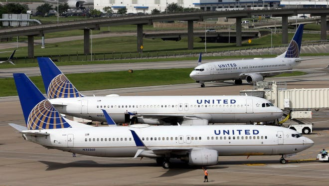 A United Airlines jet is pushed back from a gate at George Bush Intercontinental Airport in Houston on July 8, 2015.
