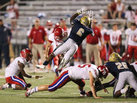 Pearl's Tylan Knight attempts to block a Warren Central