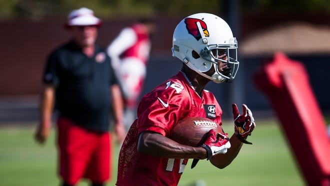 Wide receiver John Brown returns a punt during Arizona Cardinals minicamp at the practice facility in Tempe, Wednesday, June 8, 2016.