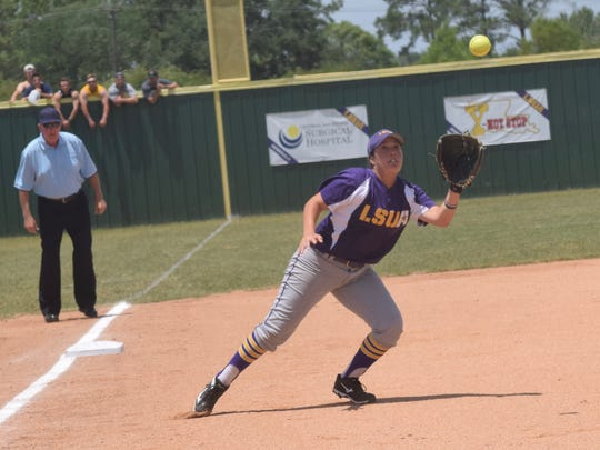 LSUA's PJ Leon (24) catches a flyball against the Unversity of Science & Arts of Oklahoma Wednesday in the NAIA Softball Championship opening round.