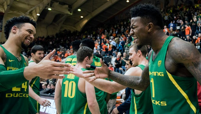 Mar 4, 2017; Corvallis, OR, USA; Oregon Ducks forward Dillon Brooks (24) and forward Jordan Bell (1) celebrate after a game against the Oregon State Beavers at Gill Coliseum. The Ducks won 80-59. Mandatory Credit: Troy Wayrynen-USA TODAY Sports