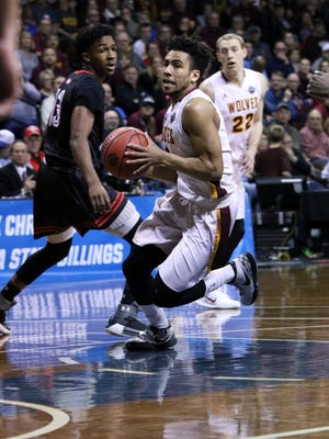 Ian Smith of Northern State cuts past the defense of Montrel Morgan of East Stroudsburg during Tuesday's NCAA quarterfinal game at the Pentagon.