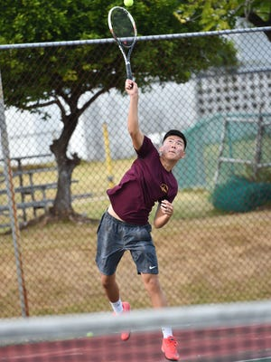 Father Duenas Friar Danny Kwon serves the ball against his George Washington Geckos opponent during an Independent Interscholastic Athletic Association of Guam Tennis League match at the Tamuning tennis courts on Feb. 18.