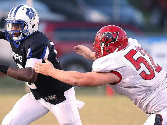Leon's Gabe Beyer chases down former Godby quarterback J.T. Bradwell during a 2013 game.
