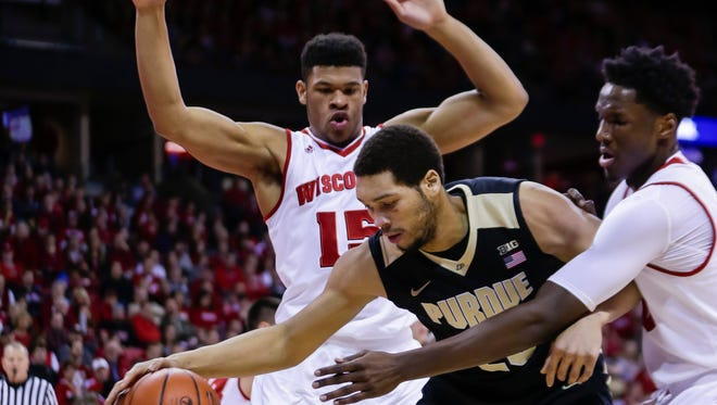 Purdue's A.J. Hammons, center, works between Wisconsin's Charlie Thomas (15) and Nigel Hayes during the first half of an NCAA college basketball game Tuesday, Dec. 29, 2015, in Madison, Wis. (AP Photo/Andy Manis)