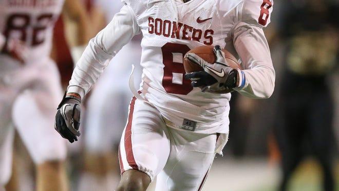 Oklahoma Sooners receiver Jalen Saunders returns a kickoff against Baylor last season.