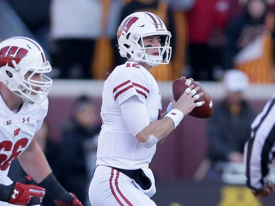 UWGRID UWGRID26 - Wisconsin Badgers quarterback Alex Hornibrook (12) looks to pass as Wisconsin Badgers offensive lineman Beau Benzschawel (66) guards during the 1st quarter of the Wisconsin Badgers vs. Minnesota Golden Gophers football game at TCF Bank Stadium in Minneapolis, Minnesota on Saturday, November 25, 2017. -  Photo by Mike De Sisti  / Milwaukee Journal Sentinel