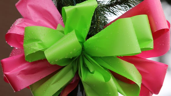 Pink and green ribbons for Holly Bobo are seen outside