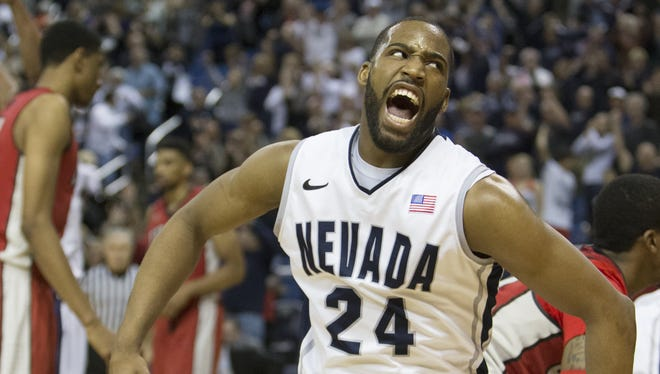 Nevada's Deonte Burton celebrates after beating UNLV at Lawlor Events Center on Saturday.