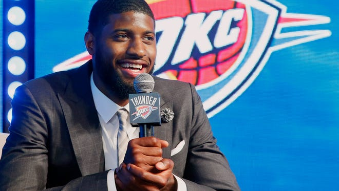 Oklahoma City Thunder forward Paul George speaks to at a rally to introduce him to fans in Oklahoma City, Wednesday, July 12, 2017.