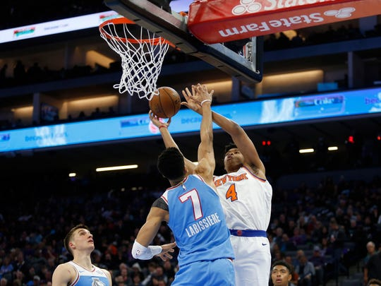 New York Knicks forward Isaiah Hicks (4) shoots the ball against Sacramento Kings forward Skal Labissiere (7) in the second quarter at Golden 1 Center.
