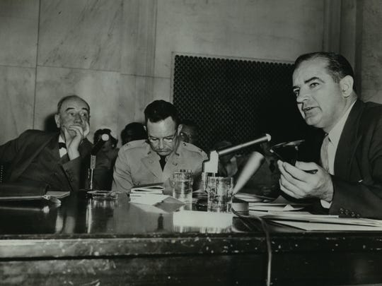 U.S. Sen. Joseph McCarthy (right) speaks as Army counsel