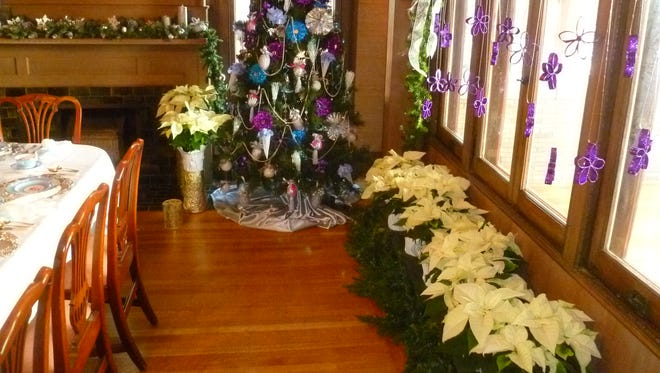 This poinsettia display within the Oakhurst home was created by The Designing Women.