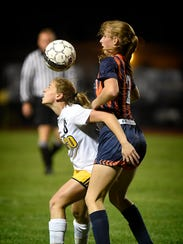 Elco's  Cassie Johnson and Hershey's Claudia Zugay battle during the AAA District opener at Elco High School Monday night, Oct. 23.