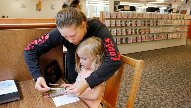 Kellie Sims helps her daughter Bailey, 3, select a pencil for drawing Friday, September 16, 2016, at the Tippecanoe County Public Library's Campus Library at Ivy Tech Community College.