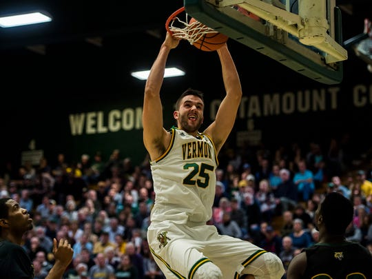 UVM's Drew Urquhart dunks, sealing a resounding lead during the first half of their men's basketball match up at Patrick Gym against the University of Main Fort Kent Wednesday night, Nov. 22, 2017.