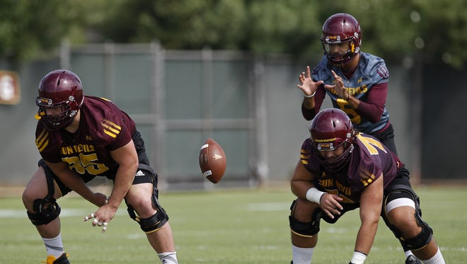 Quarterback Manny Wilkins (5) catches the snap during a drill. Arizona State held their first football practice on Tuesday at Verde Dickey Stadium.