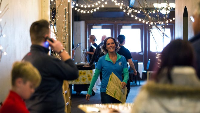 Jill Holm greets customers during the fish fry at the RiverEdge Golf Course  in Marshfield, Wis., Friday, March 30, 2018.