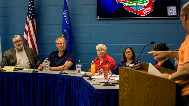 A resident speaks to the Stevens Point City Council during a special session at the Stevens Point Police Department, May 15, 2018, to hear public comment about controversial changes to Stanley Street.