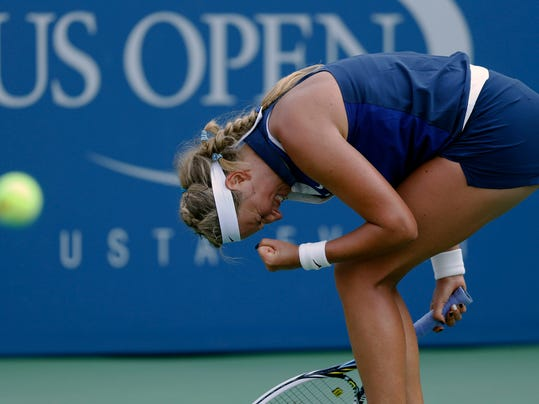 Victoria Azarenka, of Belarus, reacts after winning a game against Misaki Doi, of Japan, during the first round of the 2014 U.S. Open tennis tournament, Tuesday, Aug. 26, 2014, in New York. (AP Photo/Jason DeCrow)