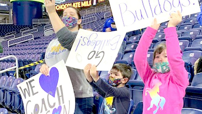 Julie, Houston and Alaina Olson show their support for Centreville High School's football team Friday at Ford Field in Detroit.