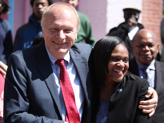 State Senator Bob Marshall and Wilmington City Councilwoman Sherry Dorsey Walker hug during a press conference Friday morning in Wilmington.  The two are working to try to reopen the Jackson St. Boys and Girls Club in Wilmington's Hedgeville section.