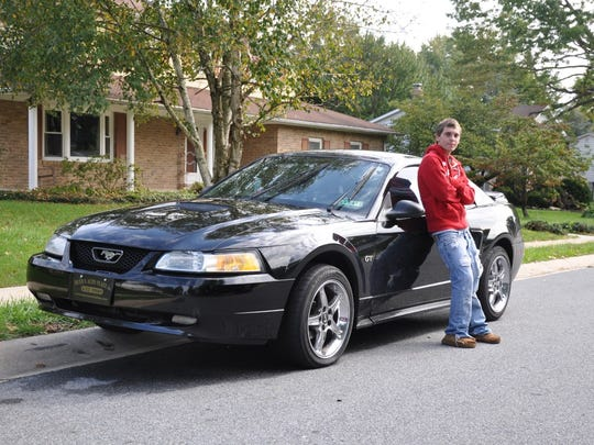 Cody and his Mustang. He loved that car, his family said. But lost it to his addiction.