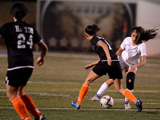 Abilene High's Estafany Hernandez tries to get past