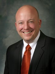 Zachary J. Cook (R) , district 59