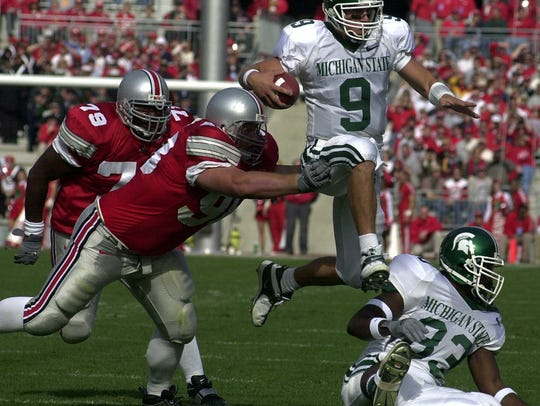 MSU quarterback Jeff Smoker tries to leap out of the