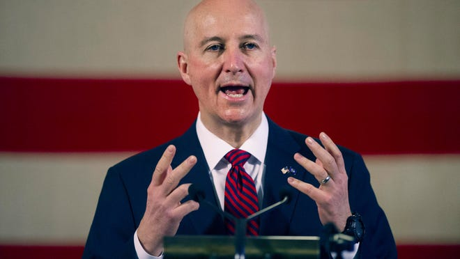 Gov. Pete Ricketts speaks during a news conference at the Nebraska State Capitol in Lincoln on Feb. 26.