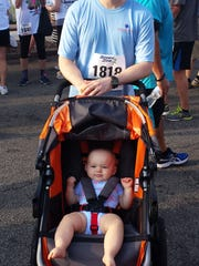 Isabella had a blast as her father, Daddy Duty columnist Tim Walters, pushed her along in the Melbourne Art Festival Flamingo 5K on April 25.