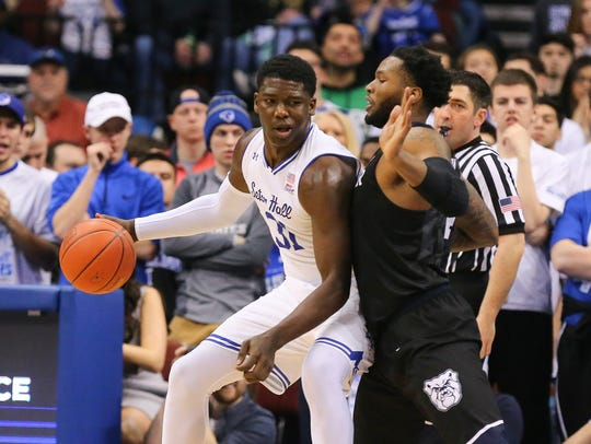 Seton Hall Pirates guard Myles Powell (13) fights for