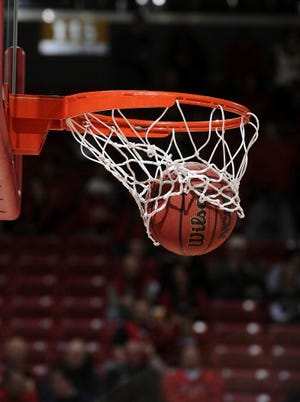 A basketball goes through the hoop.