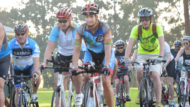 Local cyclist Stacey McMickens (center, in Le Tour de Bayou jersey) participates in the 31-mile ride of the Le Tour de Bayou. The cycling event is a fundraiser for Kent Plantation House.