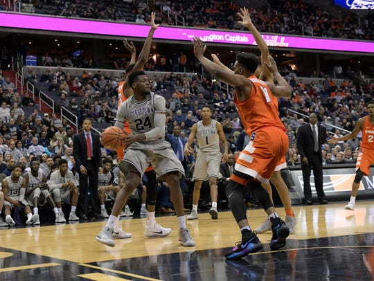 Georgetown forward Marcus Derrickson looks to pass