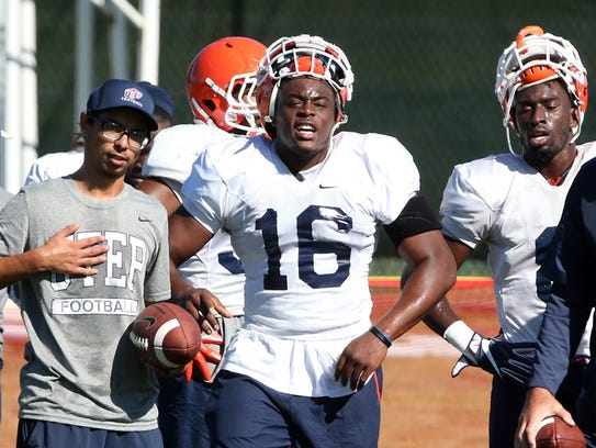UTEP senior linebacker Alvin Jones, 16, rests on the sideline during a practice at Camp Ruidoso.