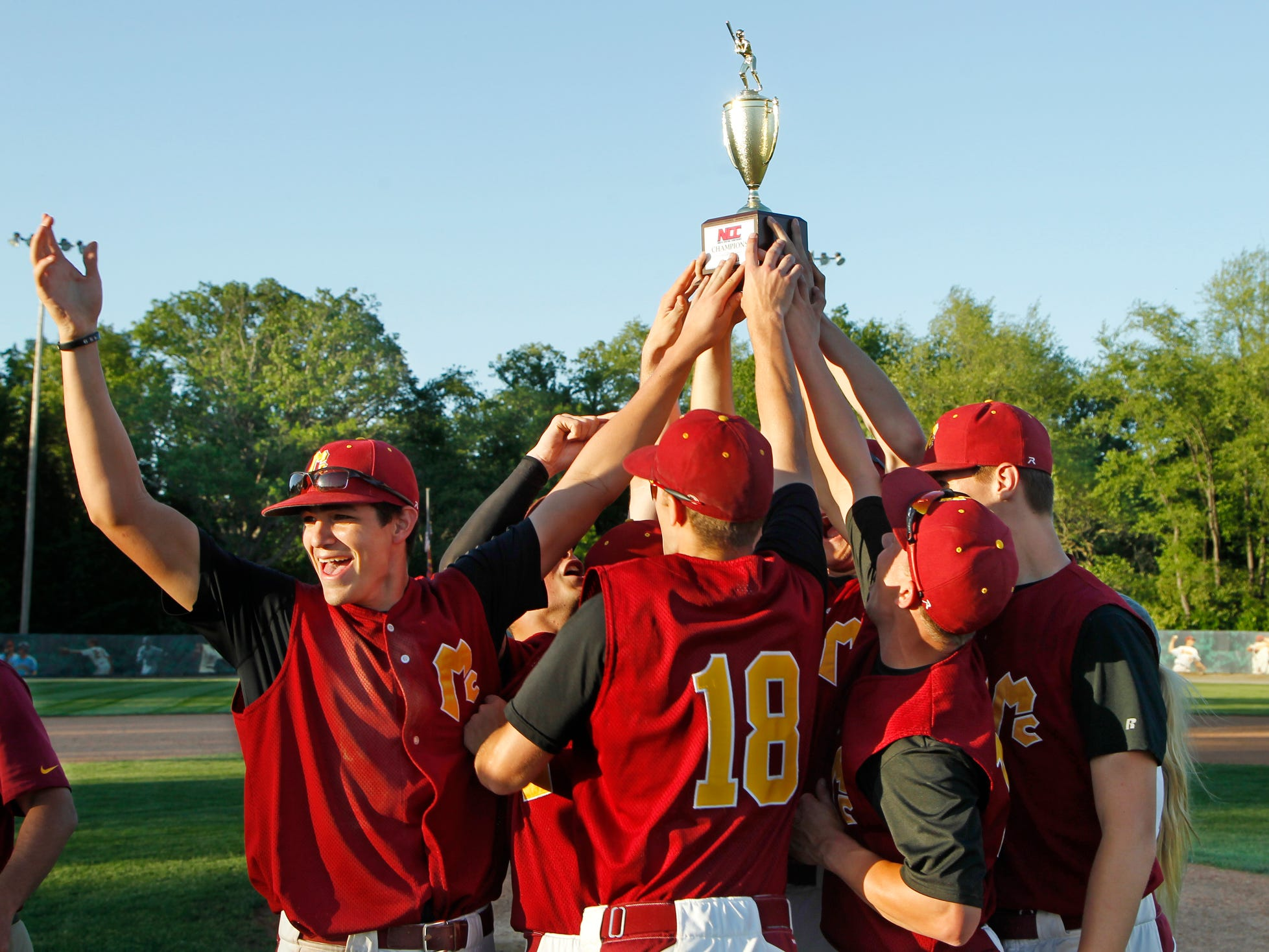 McCutcheon players celebrate after defeating rival Harrison 10-1 in the North Central Conference baseball championship Monday at McCutcheon High School. This is the first year in the NCC for both teams.