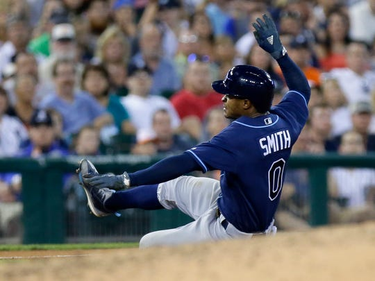 Tampa Bay Rays' Mallex Smith (0) slides into third base with a triple against the Detroit Tigers during the seventh inning of a baseball game Friday, June 16, 2017, in Detroit. (AP Photo/Duane Burleson)