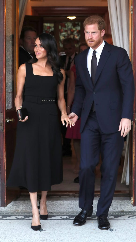 Prince Harry and Duchess Meghan arrive for a summer party at the British Ambassador's residence at Glencairn House on Tuesday evening.