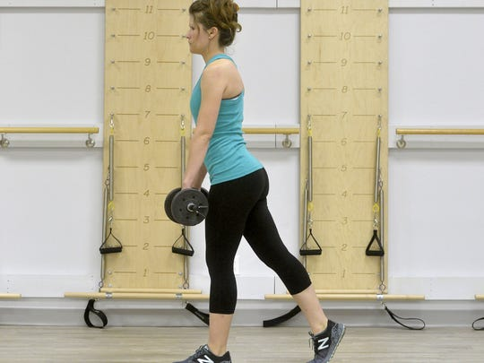For the lunge, stand tall with your feet hip-width apart while holding a dumbbell in each hand at your side. Step forward with one leg, keeping your front knee bent and your back knee straight.