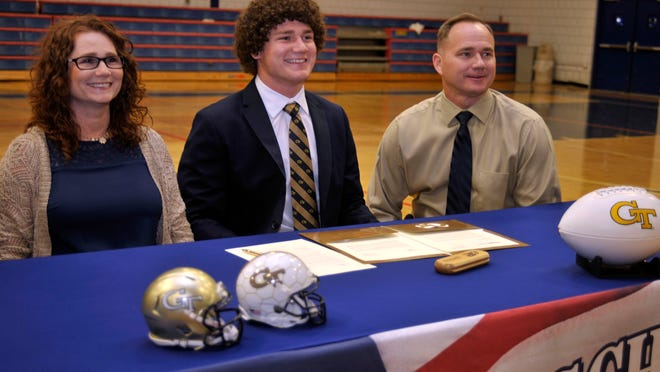 Quaide Weimerskirch of Pace High signed to play football for Georgia Tech during a ceremony Friday afternoon in the gym of Pace High. He is shown here with his parents, Carrie and Todd Weimerskirch.