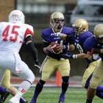 Albion College senior running back Colin Parks (21) rushed for 827 yards and 14 touchdowns in 2014.