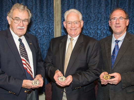 Tioga County Commissioners, from left, Roger Bunn, Erick Coolidge and Mark Hamilton were awarded Mansfield University Presidential Coins of Excellence.