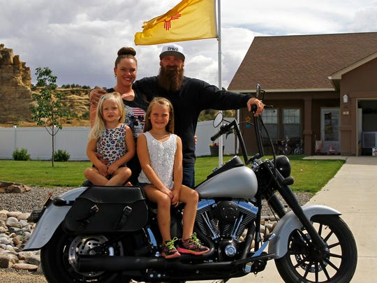 Forse Beard Co. owners Nicole and Greg Forse pose for a portrait with their daughters Klhoe and Kyla Forse on Wednesday at their home in Bloomfield.