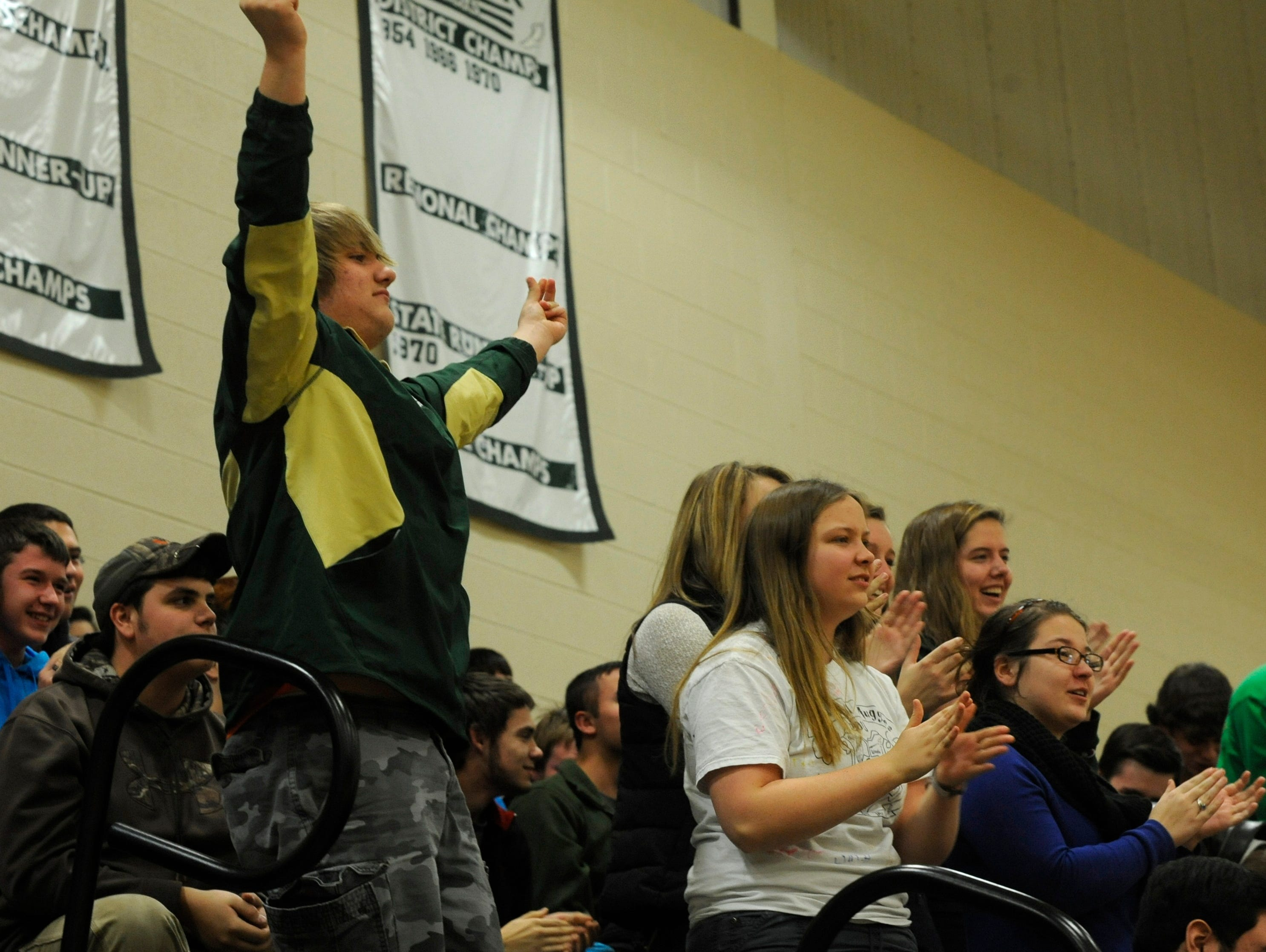 Students cheer during Wilson Memorial's winter sports and football state championship recognition pep rally on Friday in Fishersville.