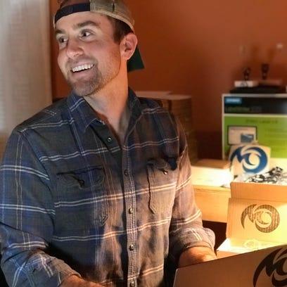 "Pinckney native Jeff Cremonte works in his ""office,"""