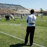 Head coach Darrell Hazell watches his player during the Purdue spring football game Saturday, April 16, 2016, at Ross-Ade Stdadium. The Black team defeated the Gold 23-17.